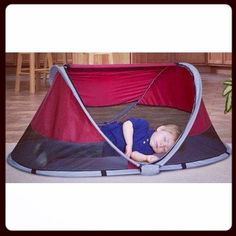Leave the pack-n-play at home and opt for this space saving portable baby bed. http://amzn.to/1mE1ye2  PeaPod Travel Bed in Cranberry by Kidco