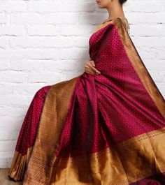 Gorgeous wine and gold coloured silk saree. Indian fashion.