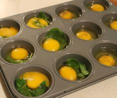 Clean Eating Prep Ahead: Eggs in Muffin Tins. Simply spray a muffin pan with olive oil cooking spray ( or wipe down each cup with Olive Oil , crack an egg into the cup, add seasoning ( a dash of hot sauce, salt & pepper, onion powder… ) and a few bits of leftover vegetables. In this case, leftover spinach. If you like, you can use a plastic fork to slightly scramble each egg in the cup.