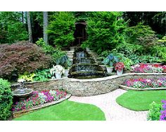 2 words. I WANT!  Manufactured Stone Retaining Wall with water feature