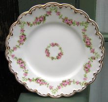 Antique Theodore Haviland Limoges Plate Schleiger #875    Pattern is Schleiger #875 On Blank 305    This Haviland Limoges Pattern Schleiger #875 Features Garlands Of Pink Roses On A Double Gold Trimmed Scalloped Blank .    SO SPECIAL!   $40.00
