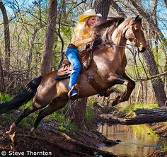 This is what I call fun!  Guthrie, Oklahoma, USA - This is the cover shot I took of Kelly and one of her horses jumping the creek. I really got something in the 2nd jump but I shot 9 total and most worked. I could not spend a lot of time due to needing to return to her ranch, put this horse in it's stall, grab 2 more, put them & the tack in the trailer and go to another location.