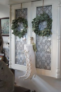 White lace, greeney wreathes and a pair of white fabric St.Nic boots!