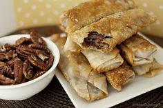 Pecan Pie Egg Rolls , a fun twist on 2 traditional recipes! Top with ice cream, and you're good to go!