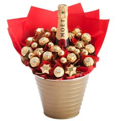 Luxury Moet Bloom - Designed for those who wish to make a statement with their gift giving, this gift lives up to it's reputation. A heavenly bottle of Moet and Chandon sits amidst a sea of delicious Belgian chocolates. Sure to impress, this is a great celebration gift!