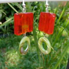 These are great summertime fun earrings.  Orange square glass like bead with green accent circle bead.  These are medium  weight earrings.   Very cute for that summertime party.