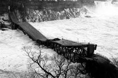 On January 27, 1938 the Honeymoon Bridge (or Falls View Bridge) collapsed into the Niagara Gorge. #NiagaraFalls #Bridges #NiagaraHistory  http://www.cliftonhill.com/falls_blog/niagara-falls-bridge-collapse/