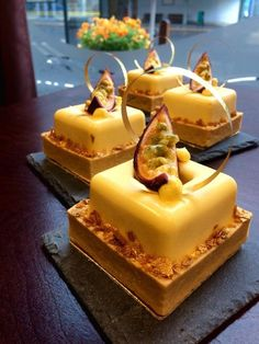 Mango and passion fruit mousse in a lovely crispy vanilla tart, filled with vanilla and mango cream. #Mango #passionfruit #fruit #exotic #cake #tart #mousse #gold #fristelsecafe