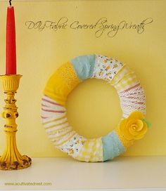 This is a great project that uses up those little scraps of fabric leftover from other projects. Super easy to make and allows you to re-use your wreath form when you're tired of this look.| DIY Fabric Wrapped Wreath