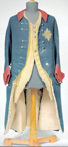 Uniform worn by Frederick II. of Prussia during the Battle of Kunersdorf (today Kunowice) in 1759 (Prussia lost). Remarkably humble, compared with the bling bling sported by his fellow monarchs (I'm looking at you, Louis Quinze...) And the man didn't just send his soldiers to battle, he risked his own neck as well. See that rip on the left side, below the fourth button? That was a bullet which luckily bounced off the royal snuff box (or so the legend goes).