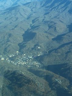 A spectacular aerial view of Gatlinburg and the Smoky Mountains surrounding it Tennessee Smokies, Gatlinburg Tennessee, Gatlinburg Cabins, Tennessee Vacation, Greenville Tennessee, East Tennessee, Smoky Mountain Cabin Rentals, Smoky Mountains Cabins, Great Smoky Mountains