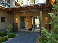 """This porch not only makes a great first impression, it's also specifically designed to withstand the harsh winter elements. The flat central roof can withstand more than 8 feet of piled snow. Pairs of thick 4-by-8-inch wooden beams along with steel supports make this roof strong enough to """"park a freight train,"""" says project contractor Mike Efstratis."""