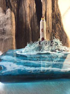 Resin Lighthouse Sculpture Water Diorama Lighthouse on Beach Water Sculpture, Driftwood Sculpture, Resin Sculpture, How To Make Resin, Wave Jewelry, Epoxy Resin Art, Beach Stones, Blue Heron, Festival Decorations