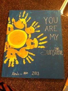 Is it sad that I want to do this with my kids for my Mother's Day present? . Kids handprint canvas pictures....good times :)