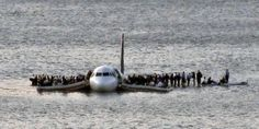 US Airways Flight 1549 floats on the Hudson river after crash landing, miraculously, everyone survived [2009]