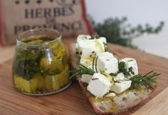 Feta cheese marinated in extra virgin olive oil, herbs and lemon is a super-easy appetizer or hostess gift that will make you look like a culinary rock star.