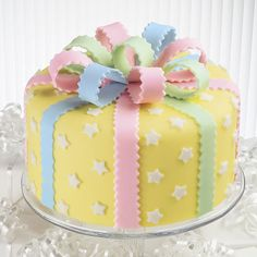 It's fun to match the cake to the celebration! This cake can be decorated in any color scheme. With a pretty bow on top, this cake is all wrapped up and ready to party in easy-to-use fondant. Watch our online video. Fondant Cake Designs, Fondant Flower Cake, Fondant Bow, Fondant Cakes, Cupcake Cakes, Fondant Tutorial, Fondant Figures, Cake Decorating With Fondant, Cake Decorating Tips