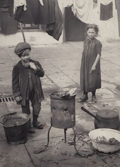 Washing Day, Horace Warner's photograph of children boiling up hot water for laundry