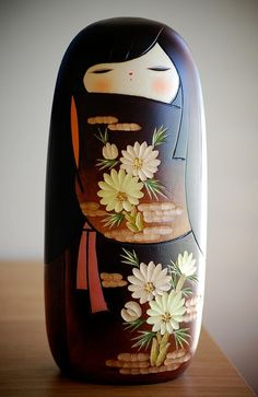 kokeshi doll:  carved out shape of hair around face