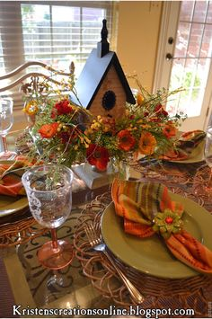 Spring tablescape by Kristen's Creations using Pier 1 Multi-Stripe Napkins and Mint Daylily Napkin Rings.