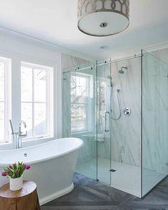 Master bathroom idea with deep soaker tub and corner shower with glass walls. Walk-in shower has statement marble slab feature wall. Spa-like bathroom inspiration Spa Like Bathroom, Bathroom Renos, Bathroom Flooring, Modern Bathroom, Small Bathroom, Bathroom Ideas, Bathroom Designs, Bathroom Remodeling, Bathroom Showers