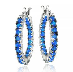 $32.99 Sterling Silver Blue Opal Inside Out Hoop Earrings Round, glistening genuine Blue Opal stones are individually prong-set on the inside and outside of these hoops, facing the front.