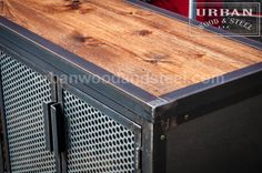 This bigger version of our bunker can accommodate all your storage needs. The steel sides and front of this unit are accented by an ebony stained wood top and back, framed with waxed raw steel. There is one adjustable shelf on each side behind the galvanized, perforated 16 gauge