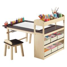 Guidecraft Deluxe Art Center - The Guidecraft Deluxe Art Center is loaded with great features that will keep your kids inspired. This art center has a large 47 x 30-inch tabletop,...