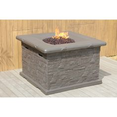 "Light up the night and dash away the evening chill with the Sasha fire pit from Bellini. This 42"" square structure makes both an elegant focal point in your outdoor space and provides the light and warmth you need to keep the party going well into the night. When not in use, the dark grey brick-like walls and smooth tabletop with decorative glass can simply be used as an attractive table. When a propane tank (not included) is added, you can enjoy the warm glow of a real fire.   Product…"