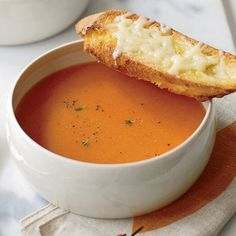 Mild Spanish smoked paprika — also called pimentón — gives dishes an appealing smokiness. Using the sweetest, ripest tomatoes in season, Melissa Rubel makes a simple yet luscious soup flavored with smoked paprika and served with crunchy cheese toasts. Recipe: Smoky Tomato Soup with Gruyere Toasts   - TownandCountryMag.com Tomato Soup Recipes, Wine Recipes, Cooking Recipes, Spicy Recipes, Cheese Recipes, Recipes Dinner, Veggie Recipes, Korma, Biryani
