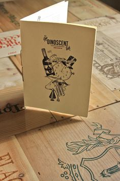Oinoscent  Athens, Greece    Designed by Marios Karystios.    Printed in-house on an inkjet printer, hand stitch-bound, and accentuated by a potpourri of imperfect illustrations, Oinoscent's always changing list focuses on the sensual side of wine consumption.