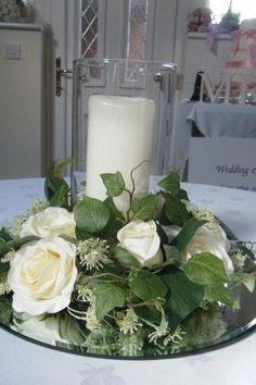 Lovely table decoration flowers with candle