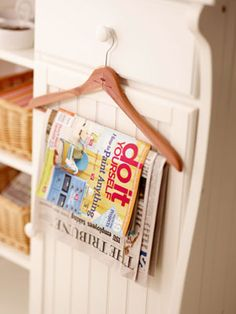 DIY - Hangers to hold magazines and newspapers.