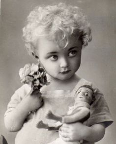 Adorable Little Girl Holding Doll with Funny Expression Beautiful Angelic Child Toy Flower Bouquet Vintage 1920s Black & White Photography