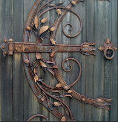 Vintage iron hinge fixed atop a garden gate (Savannah, GA)