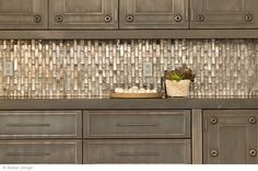 distressed cabinets with an amazing metallic backsplash - sublime decor