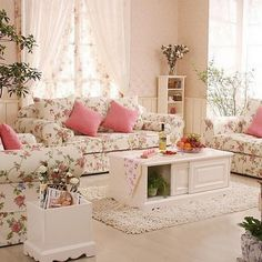 What a delightful living room....love the rose fabric and all the pinks!!