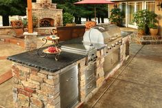 Galaxy Outdoor is the nation's premier designer and builder of custom outdoor kitchens. They manufacture custom built cabinets for outdoor kitchen islands, fire pits, fire tables, Kamado Smoker Grills and other outdoor accessories. Contact Imagine Backyard Living to make your outdoor dream a reality with Galaxy Outdoor!