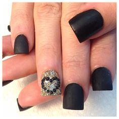 Matt black nails with gold and rhinestone heart