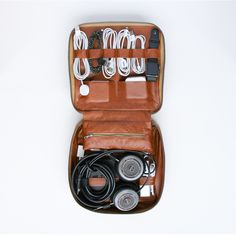 A zip-up organizer with a designated home for each of your tech accessories. With room on both sides to strap down your cords, adapters, headphones, and other necessities, the Tech Dopp Kit uses space wisely for prime portability. Avoid losing smaller items with its centrally-located internal zipped pouch.