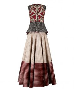Red and beige Lehenga with hand woven designs. This Lehenga comes with a matching cap sleeves peplum jacket blouse featuring floral cut work, sequins and zari embroidery. Round neckline with zipper front. Wash Care: Dry clean onlyClosure: Zip at side