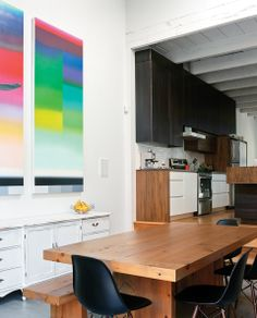 Montreal architect Marc-André Plasse of Nature Humaine - Minimalist dining area kitchen with colorful wall art of a century-old montreal house