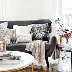 Like marble+gold table with comfy couch and throw pillows. But probably too girly for D...