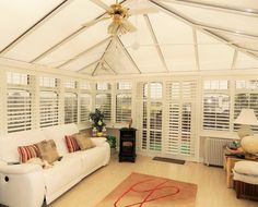 We fitted these Plantation Shutters in a conservatory in Co Waterford. They are in 'Silk White' with a centre tilt wand and inch louvres. The shutters help keep the conservatory in… Conservatory Interiors, Conservatory Decor, Conservatory Insulation, Sunroom Decorating, Interior Design Software, Dog Rooms, Guest Bedrooms, Living Room Kitchen, Shutters