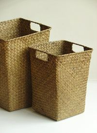 """Woven Seagrass Wastebasket  Woven seagrass, a highly renewable source, creates a sturdy and and eco-friendly wastebasket for the home. Complete with handles, the Woven Seagrass Wastebasket also works as a small storage basket. Available in two sizes.     Sizes:   Small: 8 1/4"""" W x 11 1/4"""" H x 8 1/4"""" D   Large: 10 1/4"""" W x 13 1/2"""" H x 10 1/4"""" D"""