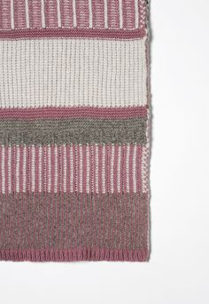 Wool blend scarf. The worked yarn is characterized by a mix of stitches that creates an alternating jacquard striped effect. <br> Size: H35 cm x W170 cm