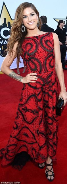 Lady in red: Voice winner Cassadee Pope dazzled in a red backless dress...
