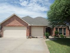410 Waurika Gorgeous 4 bedroom, 2 bathroom, 3 car garage, 2045 sqft MOL, home that's located in the highly desired Chisholm school district! Beautiful, spacious, and private fenced in backyard with no other homes behind you! I love the way the homes sits on this corner lot! It's residential, but feels like you're on more property than you are! It offers a spacious side yard and low maintenance front yard.