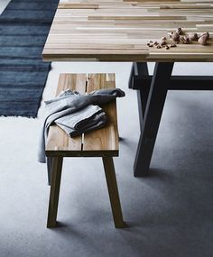 Acacia wood trestle dining table and benches | SKOGSTA collection at IKEA, designed by Marcus Arvonen.