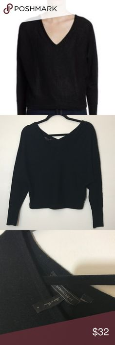"""BCBGMAXAZRIA Black Wyatt Dolman sleeve Sweater BCBGMAXAZRIA wide fit v-neck and v-back wool/nylon/cashmere Dolman Sleeve sweater size Small In good condition. 60% Wool/30% Nylon/ 10% Cashmere. From top most part of the shoulder near the neck to the hem is approximately 21"""" long From left hem to right side of hem is approximately 17"""". BCBGMaxAzria Sweaters V-Necks"""